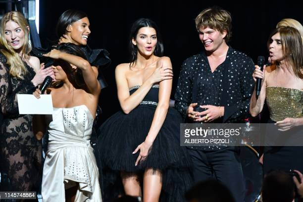 TOPSHOT French designer and fashion editor Carine Roitfeld and US actress Eva Longoria conduct a auction on stage on May 23 2019 with US model Martha...