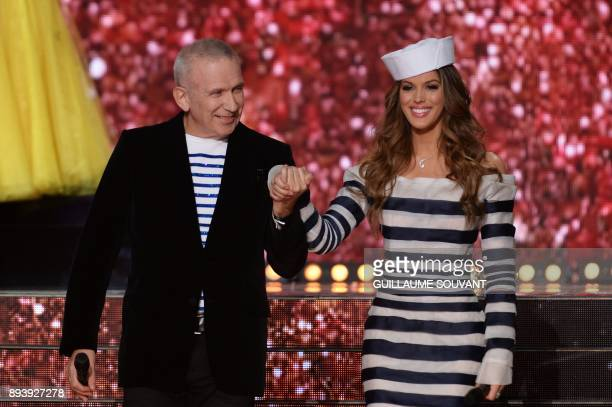 French designer and president of the jury JeanPaul Gaultier arrives on stage with Miss France 2016 Miss Universe 2016 and president of the jury Iris...