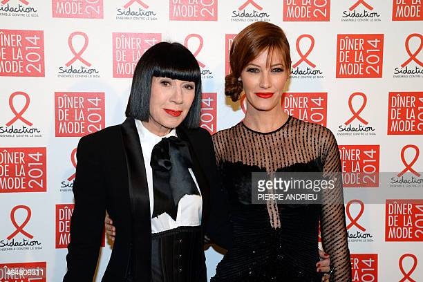 French designer Chantal Thomas and French actress Mareva Galanter pose as they arrive to take part in the fashion dinner against Aids an event...
