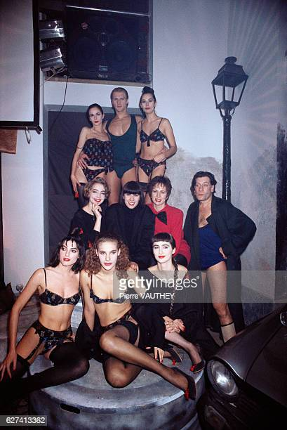 French designer Chantal Thomass is surrounded by models wearing her latest lingerie collection Joining her is French actor JeanClaude Dreyfus