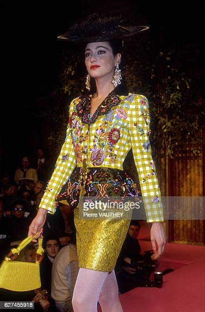French designer Christian Lacroix shows his women's 1991 springsummer haute couture line in Paris Model Anne Rohart is wearing a checked embroidered...