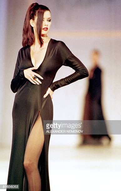 French designer Claude Montana shows a black slit sheath with plunging nuckline in Moscow 26 November Russian Italian and French designers showed...
