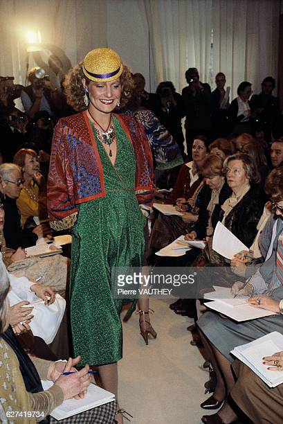 French designer Emanuel Ungaro shows his 1979 springsummer women's haute couture collection in Paris The model is wearing a green dress with a bolero...