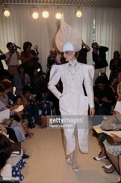 French designer Emanuel Ungaro shows his 1979 springsummer women's haute couture collection in Paris The model is wearing a white dress paired with...