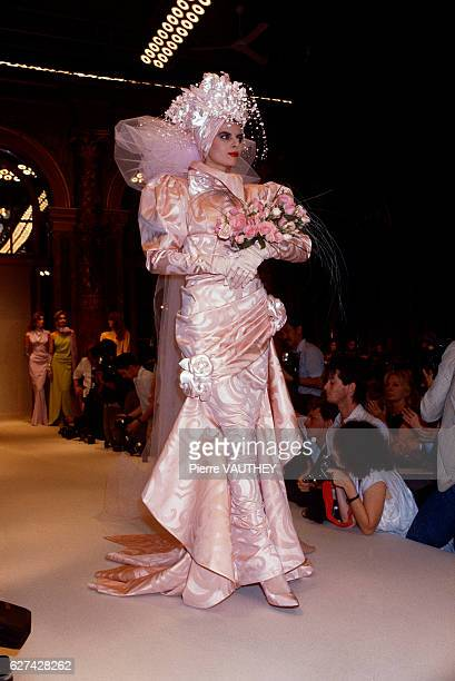 French designer Emanuel Ungaro shows his 19851986 fallwinter women's haute couture line in Paris The model is wearing a gathered light pink wedding...