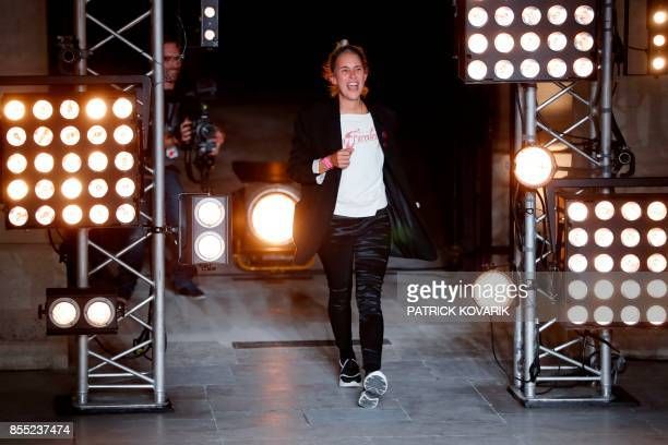 French designer Isabel Marant acknowledges the public at the end of her women's 2018 Spring/Summer readytowear collection fashion show in Paris on...