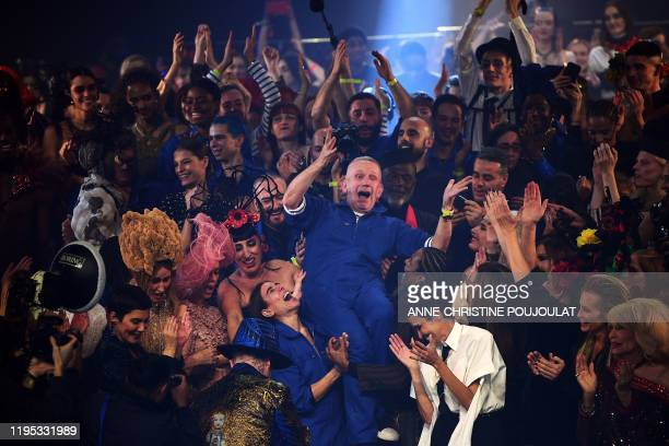 French designer Jean Paul Gaultier celebrates with models at the end of his Women's SpringSummer 2020 Haute Couture collection fashion show in Paris...