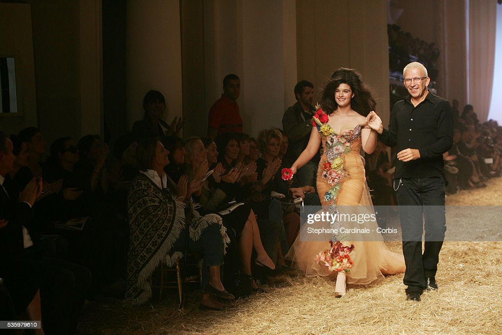 French designer Jean Paul Gaultier with model Crystal Renn on the catwalk at the Jean-Paul Gaultier ready-to-wear Spring-Summer 2006 fashion show.