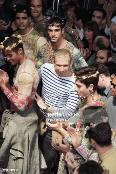 French designer JeanPaul Gaultier appears among his models 03 July 1993 in Paris during the 94 Spring/Summer men's readytowear collection show French...