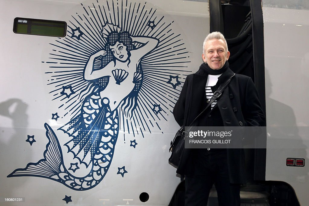French designer Jean-Paul Gaultier poses on a platform in front of a Thalys train at the Gare du Nord railway station in Paris, on February 6, 2013, as part of the launch of the exhibition 'The Fas...