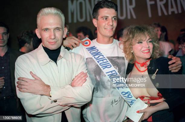 """French designer Jean-Paul Gaultier , poses with François Rocca """"Monsieur France"""" along with the star of Alcazar transvestite Marie-France 31 March..."""