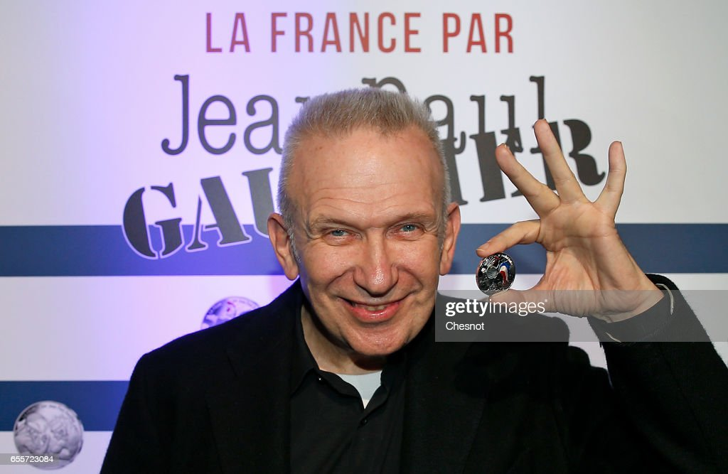 French designer, Jean-Paul Gaultier shows a coin during the launch of a serie of collection limited coins on March 20, 2017 in Paris, France. 'La Monnaie de Paris' called on the creator to produce his 2017 collection of precious metal coins called 'France by Jean-Paul Gaultier'.