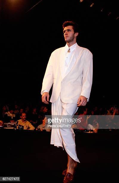 French designer JeanPaul Gaultier shows his 1985 springsummer men's readytowear line in Paris The model is wearing a white tuxedo jacket