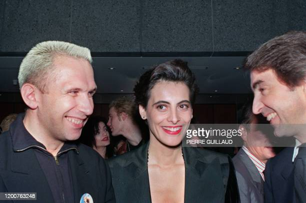 French designer Jean-Paul Gaultier talks with Ines de La Fressange and her husband Luigi d'Urso during a Gala reception against AIDS, 26 October...