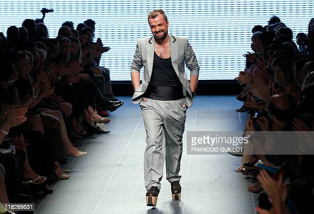 French designer Julien Fournie acknowledges the public at the end of the Fall/Winter 2011-2012 Haute Couture Collection Show on July 5, 2011 in...