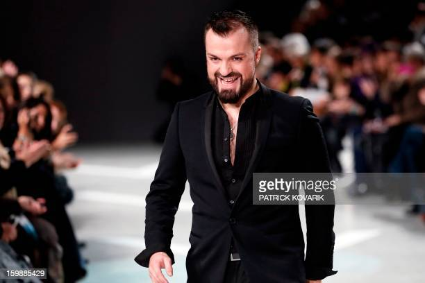 French designer Julien Fournie acknowledges the public at the end of his Haute Couture SpringSummer 2013 collection show on January 22 2013 in Paris...