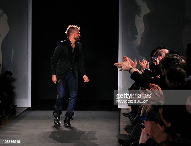 French designer Julien Fournie acknowledges the public following the Spring-Summer 2011 Haute Couture Collection Show on January 25 in Paris. AFP...