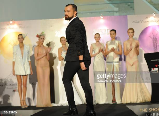 French designer Julien Fournie presents his creation during a media preview for upcoming Women's Fashion Week and Haute Couture 2012 in Singapore on...