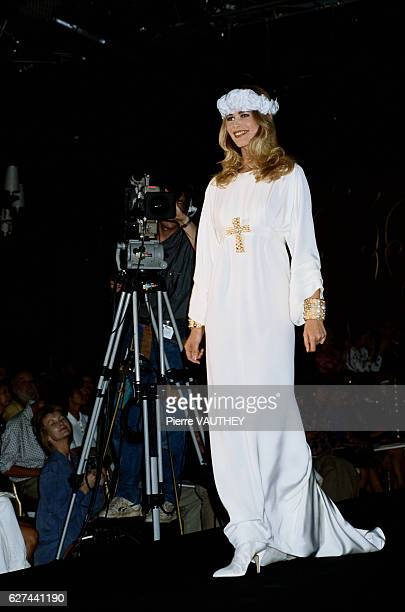 French designer Karl Lagerfeld of Chanel displays his women's haute couture line at the 19901991 AutumnWinter fashion show in Paris Model Claudia...