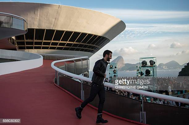 French designer Nicolas Ghespiere appears after the presentation of the Louis Vuitton 'Cruise' 2017 collection at the Contemporary Art Museum...