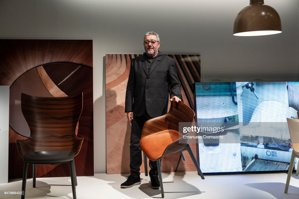 French designer Philippe Starck poses with one of his creations at the Kartell display stand during the Salone Internazionale del Mobile at Fiera di Rho on April 17, 2018 in Milan, Italy. Every year, Salone and Fuorisalone define the Milan Design Week, the most important event in the world for design. With over 2.000 exhibitors, the Salone Internazionale del Mobile (Milan Furniture Fair) is the largest furniture fair in the world. Beside that, the Fuorisalone includes a set of 1.200 events distributed all over Milan.