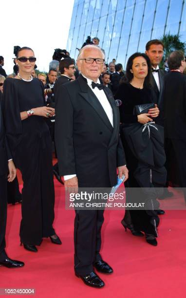 French designer Pierre Cardin arrives at the Palais des Festivals for the screening of their film The Man Who Wasn't There 13 May 2001 in Cannes The...
