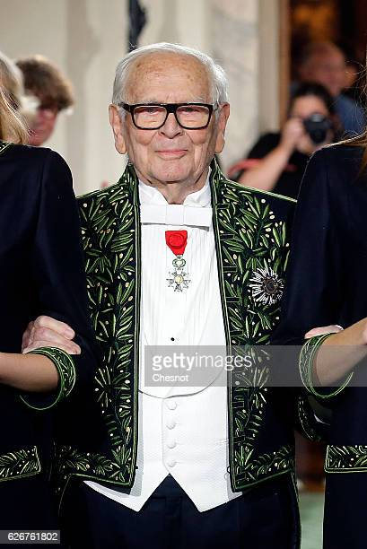 French designer Pierre Cardin member of the Academie des BeauxArts appears with models at the end of his fashion show which retraces his career and...