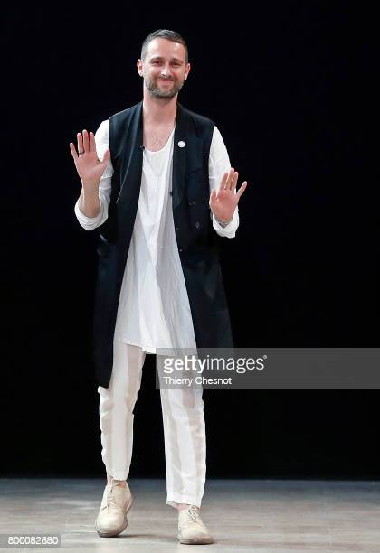 French designer Sebastien Meunier acknoleledges the public at the end of the Ann Demeulemeester Menswear Spring/Summer 2018 show as part of Paris...