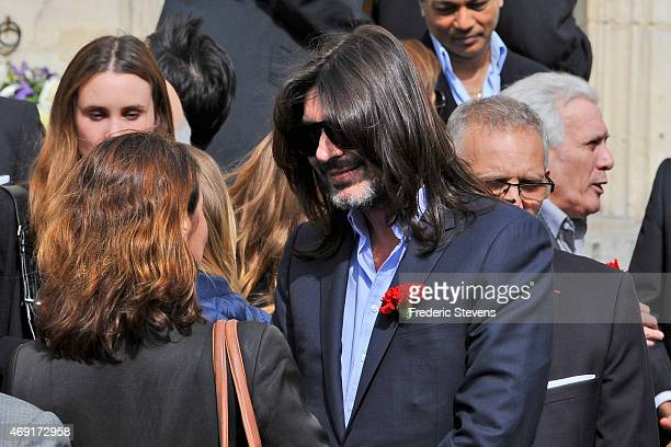 French designer Stephane Rolland leaves following the funeral of Francesco Smalto in the JeanBaptiste church on April 10 2015 in NeuillysurSeine...