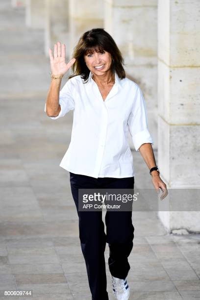 French designer Veronique Nichanian acknowledges the audience at the end of ther show for Hermes fashion house during men's Fashion Week for the...