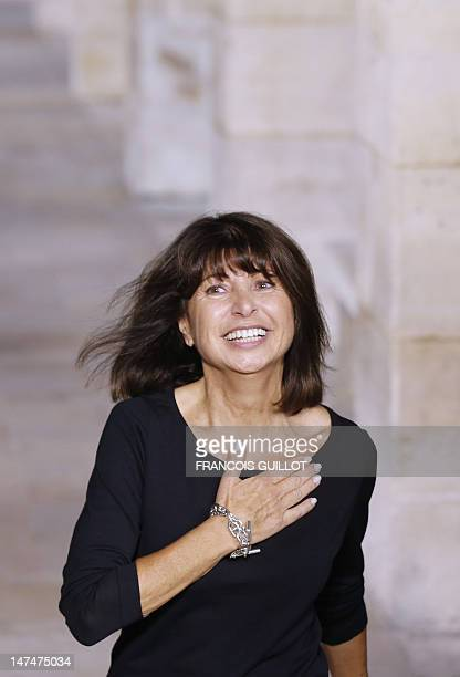 French designer Veronique Nichanian salutes at the end of the men's springsummer 2013 fashion collection show for the label Hermes on June 30 2012 in...