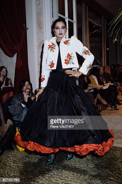 French designer Yves Saint Laurent shows his 1979 springsummer women's haute couture collection in Paris The model is wearing a Spanishinspired dress...