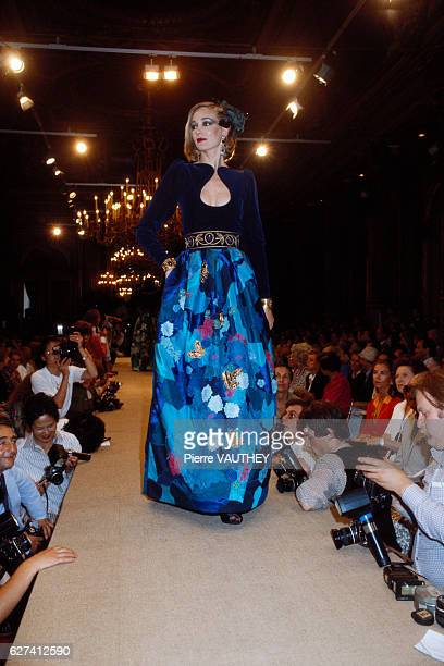 French designer Yves Saint Laurent shows his 19811982 FallWinter women's haute couture line in Paris The model is wearing a dress with a patterned...
