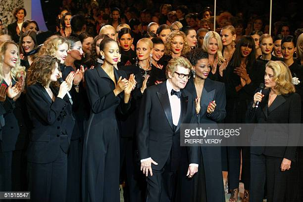 French designer Yves SaintLaurent salutes the crowd at the Centre Georges Pompidou art gallery in Paris where the last ever HauteCouture show of the...