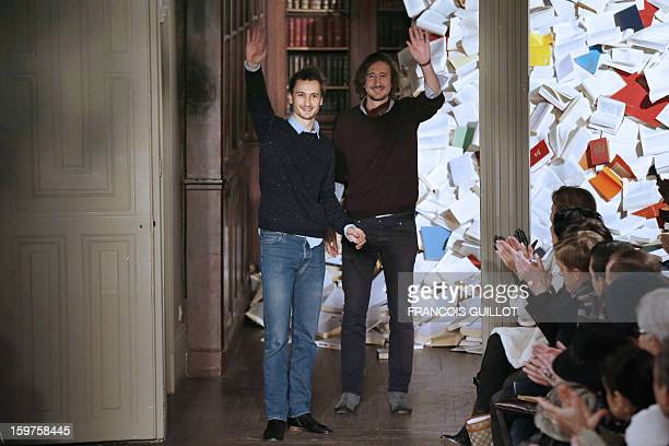 French designers Mathieu de Menonville and Remi de Laquintane acknowledge the audience at the enf of Melinda Gloss' men's FallWinter 20132014...