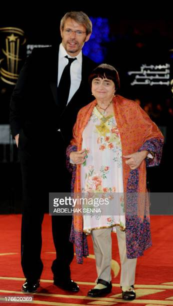 French director Agnes varda and French actor Lambert Wilson poses on the red carpet during a tribute to French cinema at the 10th edition of the...
