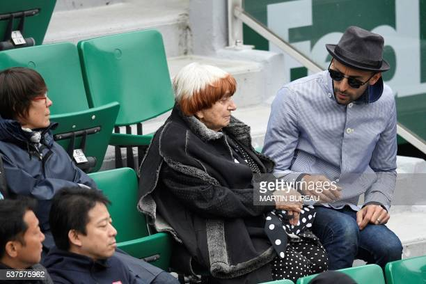 French director Agnes Varda and French photographer JR attend the men's quarterfinal match between Serbia's Novak Djokovic and Czech Republic's Tomas...