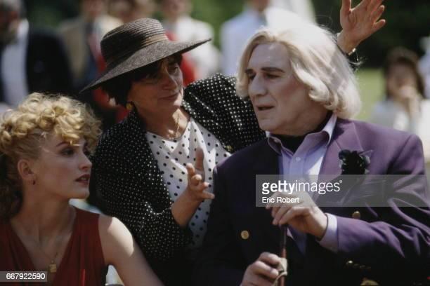 French director Agnes Varda directing French actors Julie Gayet and Michel Piccoli on the set of his film 'Les Cent et une nuits de Simon Cinéma'