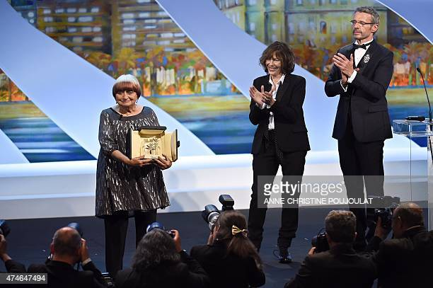 French director Agnes Varda poses on stage next to British actress and singer Jane Birkin and French actor and Master of Ceremony Lambert Wilson...