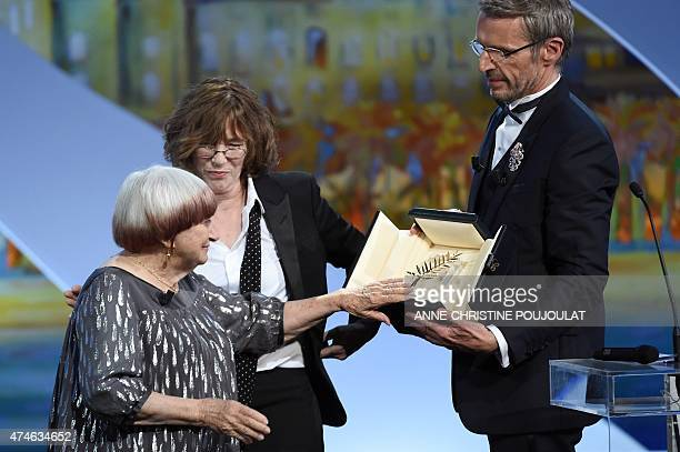 French director Agnes Varda receives an honourary Palme d'Or from British actress and singer Jane Birkin and French actor and Master of Ceremony...