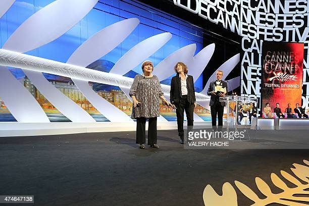 French director Agnes Varda talks on stage next to British actress and singer Jane Birkin and French actor and Master of Ceremony Lambert Wilson...