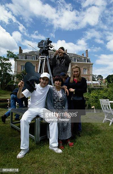 French director Agnes Varda with her daughter costuming assistant Rosalie VardaDemy and her son actor Mathieu Demy on the set of her film 'Les Cent...