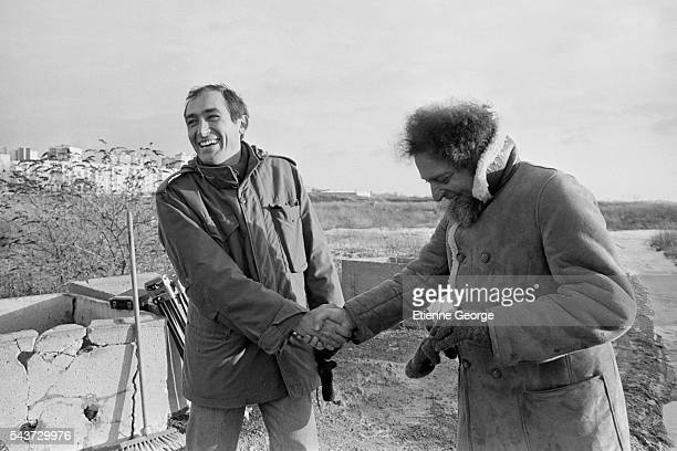 French director Alain Corneau and French writer Georges Perec on the set of Corneau's film Serie Noire based on American writer Jim Thompson's novel...