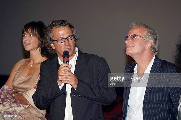 French director Alain Monne flanked by French actors Sophie Marceau and Christophe Lambert gives a speech during the presentation of his last movie...