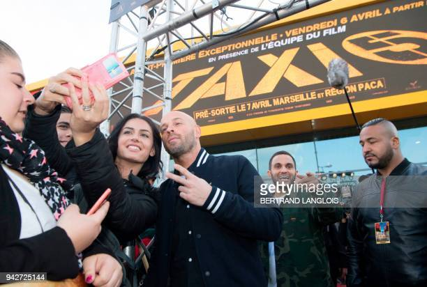 French director and actor Franck Gastambide and French actor Malik Bentalha arrive to attend a photocall for the premiere of the film 'Taxi 5' at the...