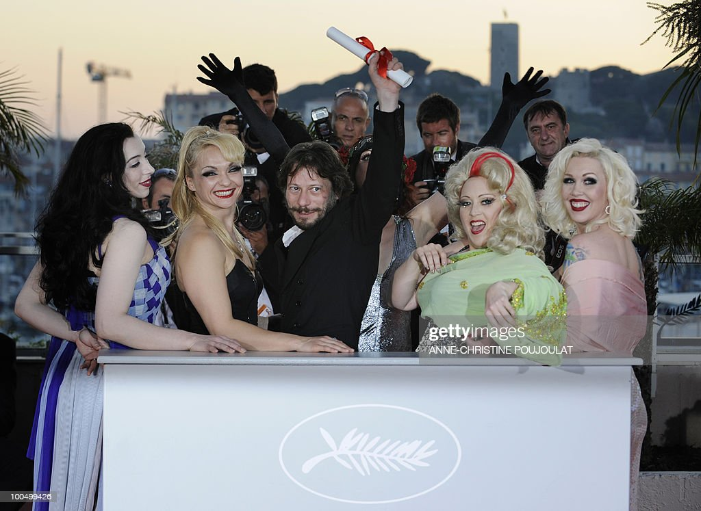 French director and actor Mathieu Amalric arrives flanked by actresses (fromL) actress Evie Lovelle, Julie Atlas Muz, Dirty Martini and Mimi Le Meaux after winning the Best Director award for 'Tournee' (On Tour) during the closing ceremony at the 63rd Cannes Film Festival on May 23, 2010 in Cannes.