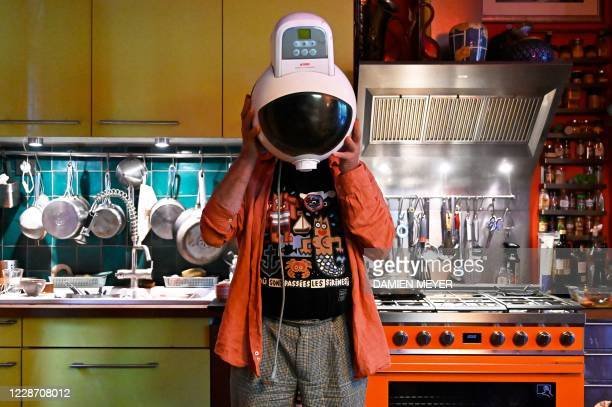 French director and founder of French street theatre company Royal de Luxe JeanLuc Courcoult plays with an electric fryer using it as an astronaut's...