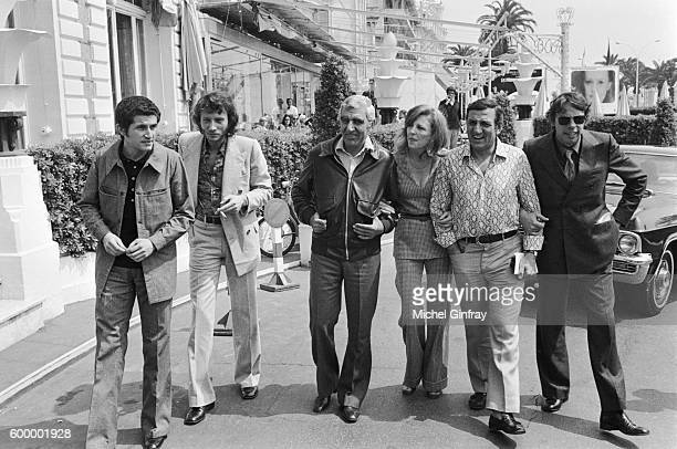 French director and screenwriter Claude Lelouch actor and singer Johnny Hallyday actors Charles Gerard Nicole Courcel Italian actor Lino Ventura and...