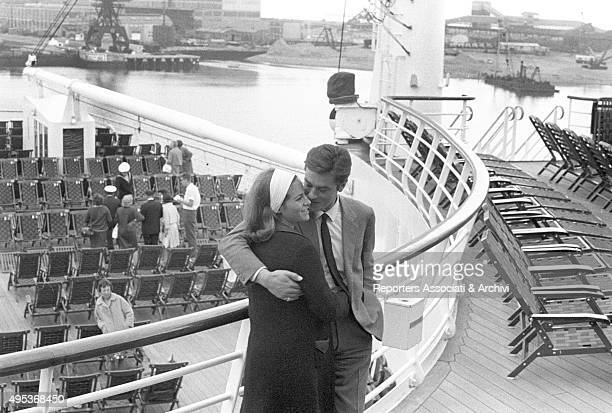 French director and singer Alain Delon and French actress Nathalie posing on a ferry boat few days before their wedding Le Havre 1964