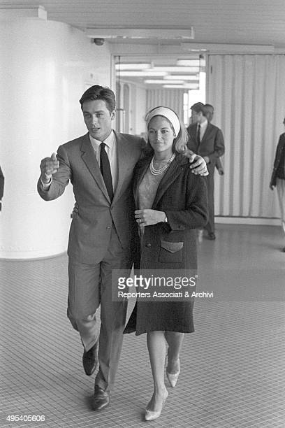French director and singer Alain Delon and French actress Nathalie walking hugging each other in the hall of a ferry boat few days before their...